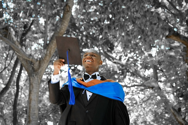 Happy person on his graduation holding a graduate cap